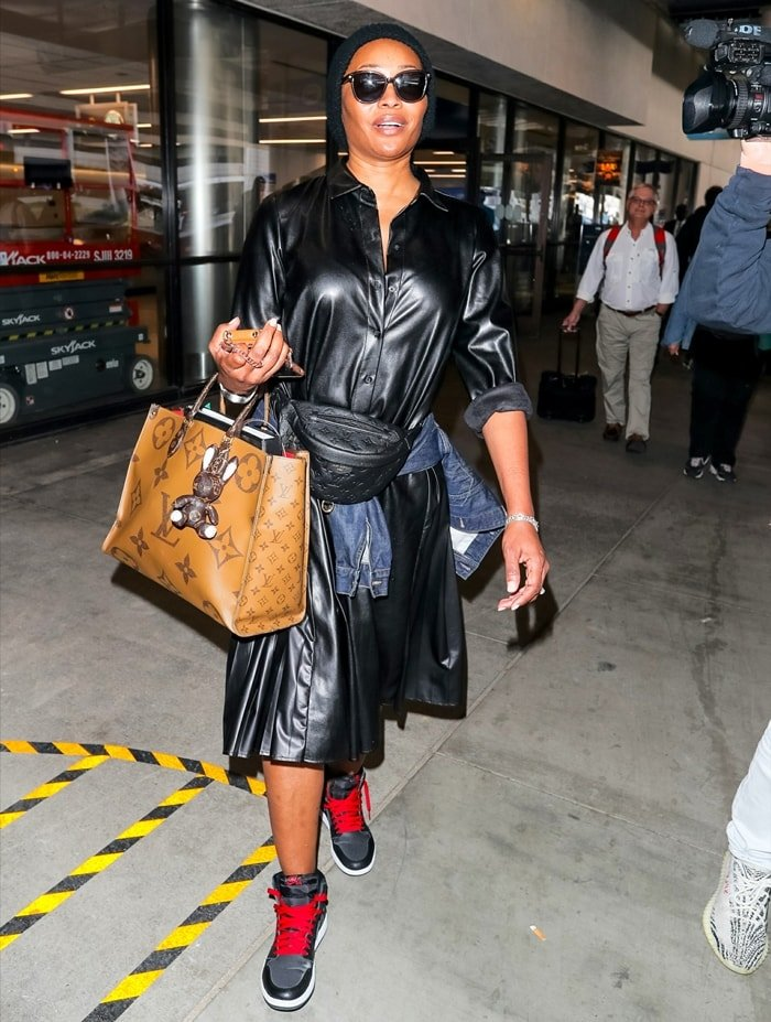Cynthia Bailey carries a large Louis Vuitton tote at LAX