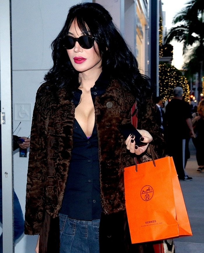 Demet Oger shopping at Hermes on Rodeo Drive in Beverly Hills, California