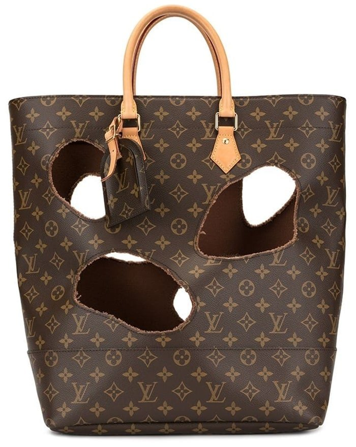 This dark brown and beige leather tote from Louis Vuitton features a monogram pattern, gold-tone hardware, round top handles, an internal logo patch, a hanging luggage tag, a drawstring closure, and a removable lining