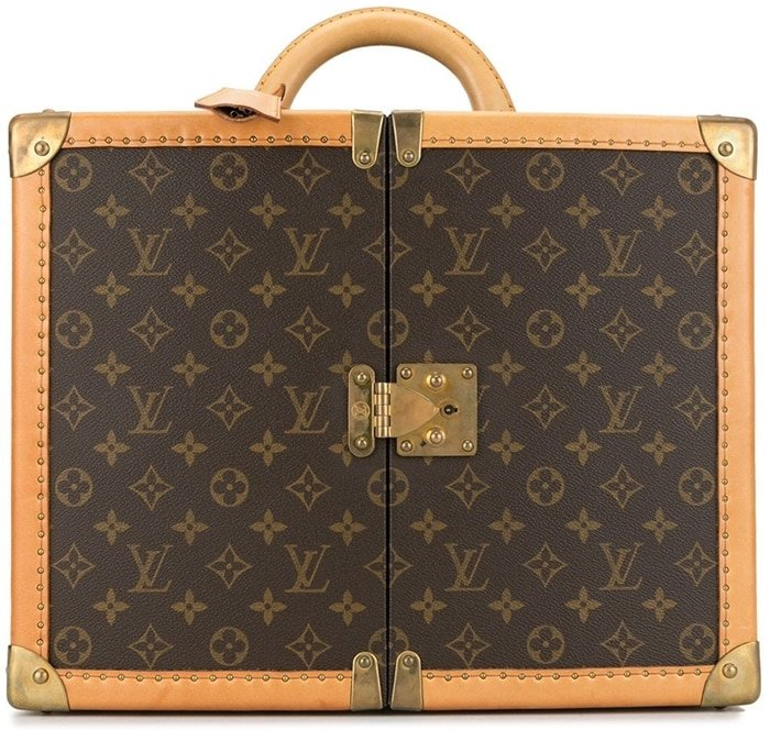 This brown leather trunk case from Louis Vuitton features a round top handle, a push-lock fastening, an all-over logo print, gold-tone hardware, a hanging key fob, an internal mirror, internal drawers, two removable logo-print bags, and two detachable shoulder straps