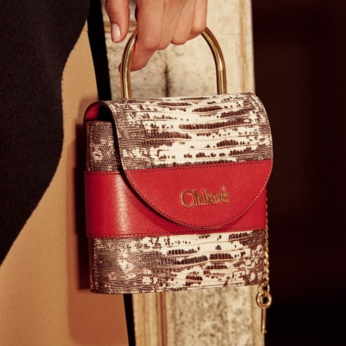 Small Aby Lock chain bag designed in the shape of the iconic padlock featured on the Maison's original Paddington bag