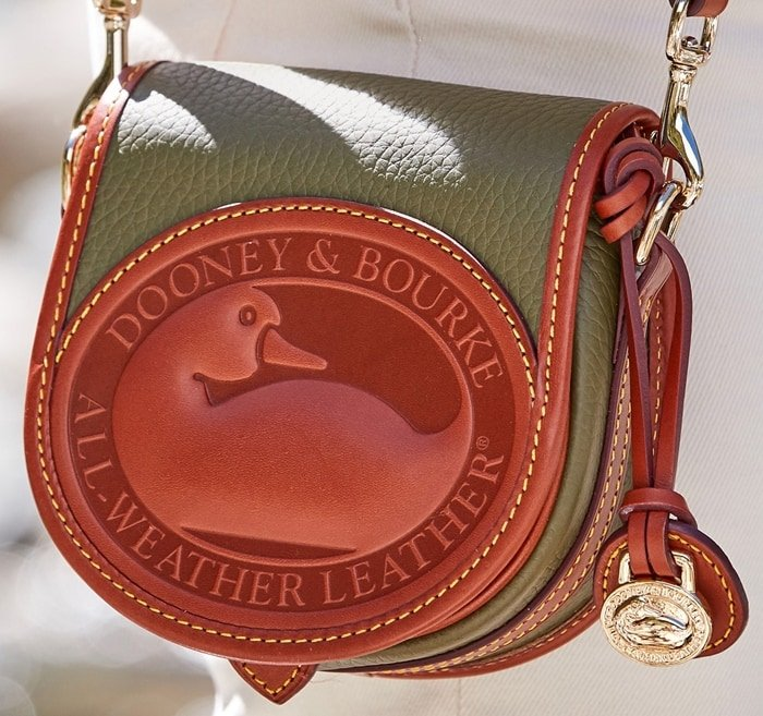 Dooney & Bourke handbags are finished with neat topstitching and polished gold hardware