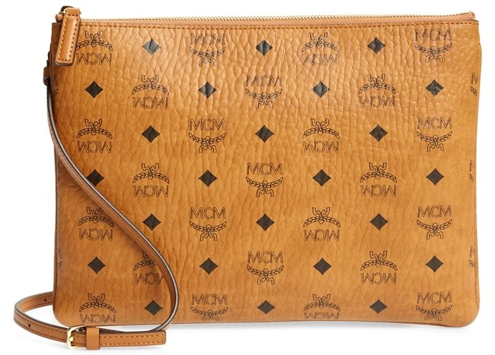 A signature logo print adds impeccable style to a streamlined cognac pouch furnished with an optional crossbody strap