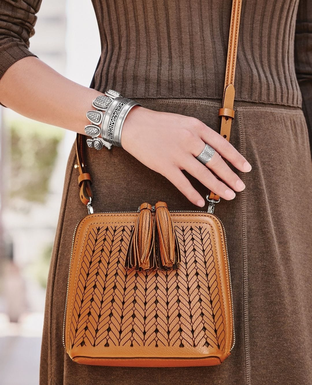 Brighton's hand-braided Vega mini crossbody bag is inspired by the clean lines and architecture of Santorini, Greece