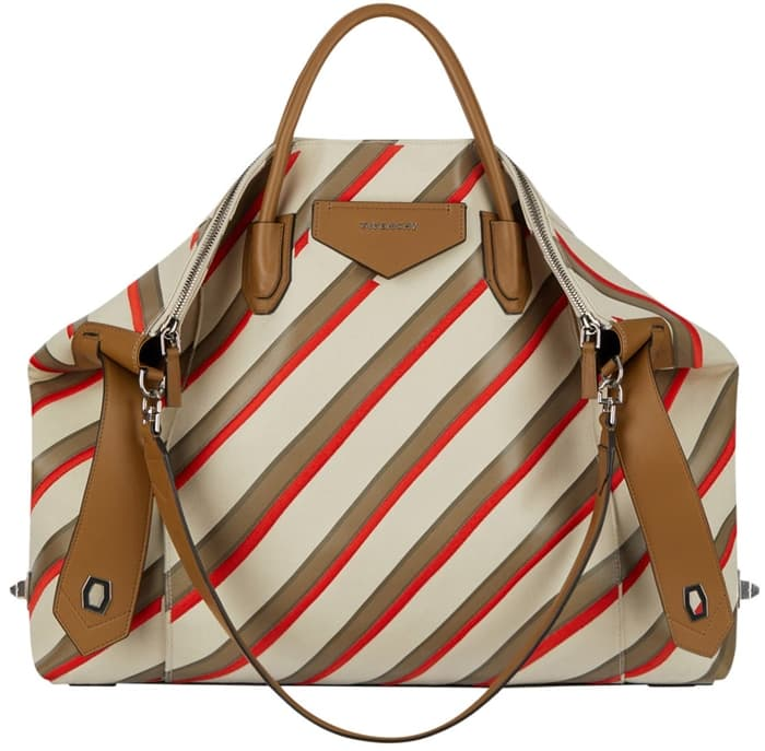Printed and embroidered racing stripes distinguish this buttery-smooth leather bag made in Italy with a slouchy shape and removable shoulder strap