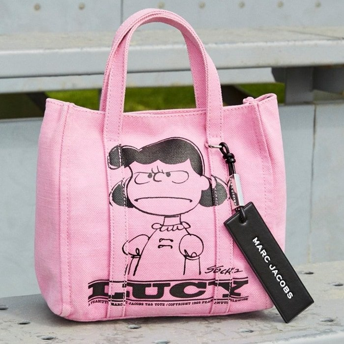 The Tag Tote pays homage to Marc Jacobs' favorite Peanuts comics with a screen-printed character on PVC-coated canvas with a signature leather logo tag