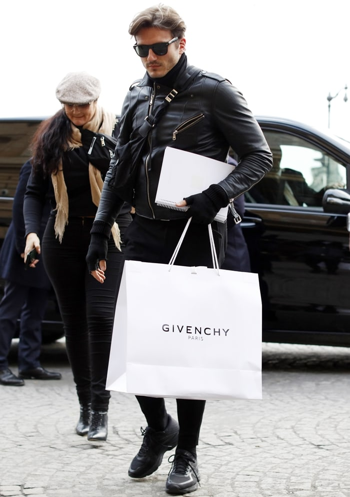Celine Dion's backup dancer and suspected lover Pepe Muñoz carrying a bag with the official Givenchy logo in Paris