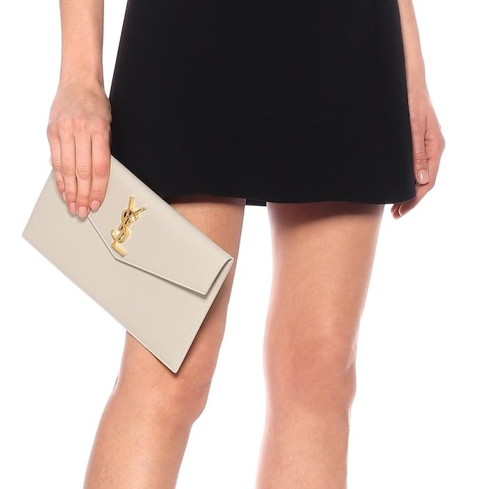 Whether you're heading to an appointment or a soirée, the Uptown leather clutch will lend any look a touch of Parisian glamour