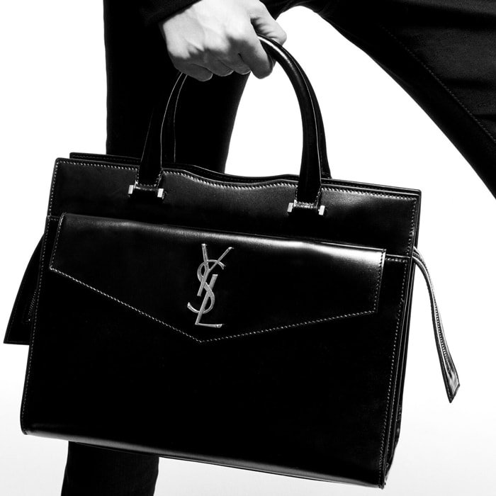 Saint Laurent's 'Uptown' bag is made from smooth glossed-leather with a structured silhouette and is detailed with a tonal monogram