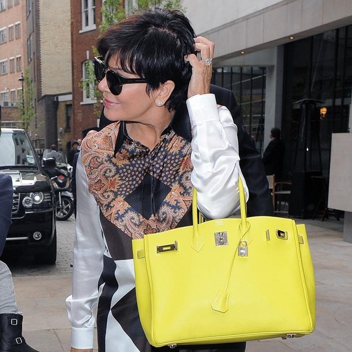 Kris Jenner carries a bright yellow Hermes Birkin bag