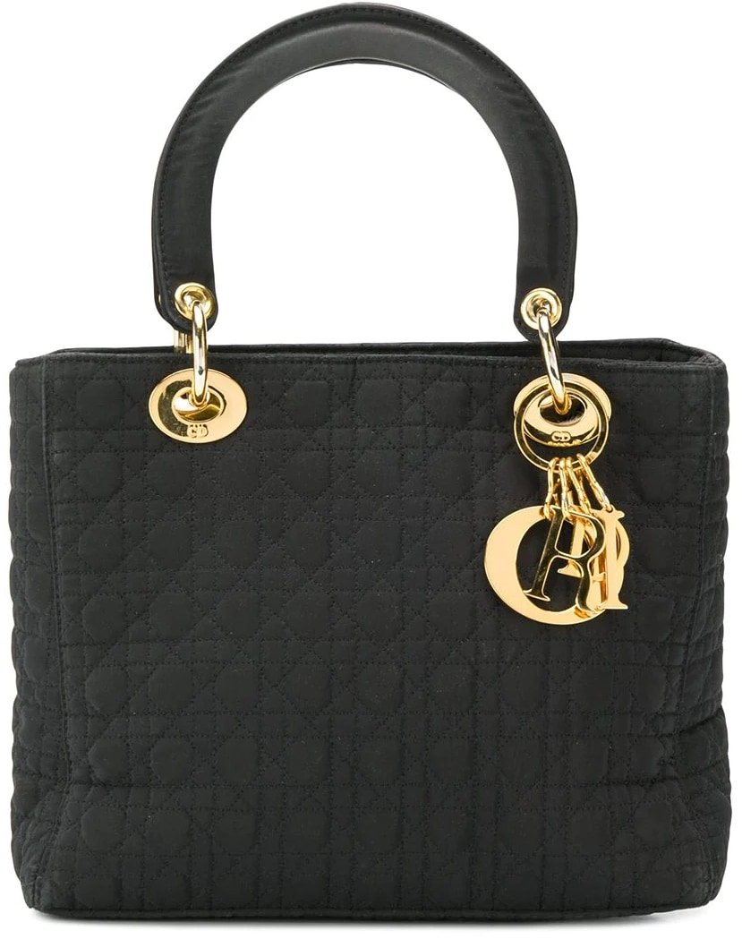 Handmade in France, a Dior bag is a declaration of grace and style, as seen in this black cotton and leather Lady Dior bag