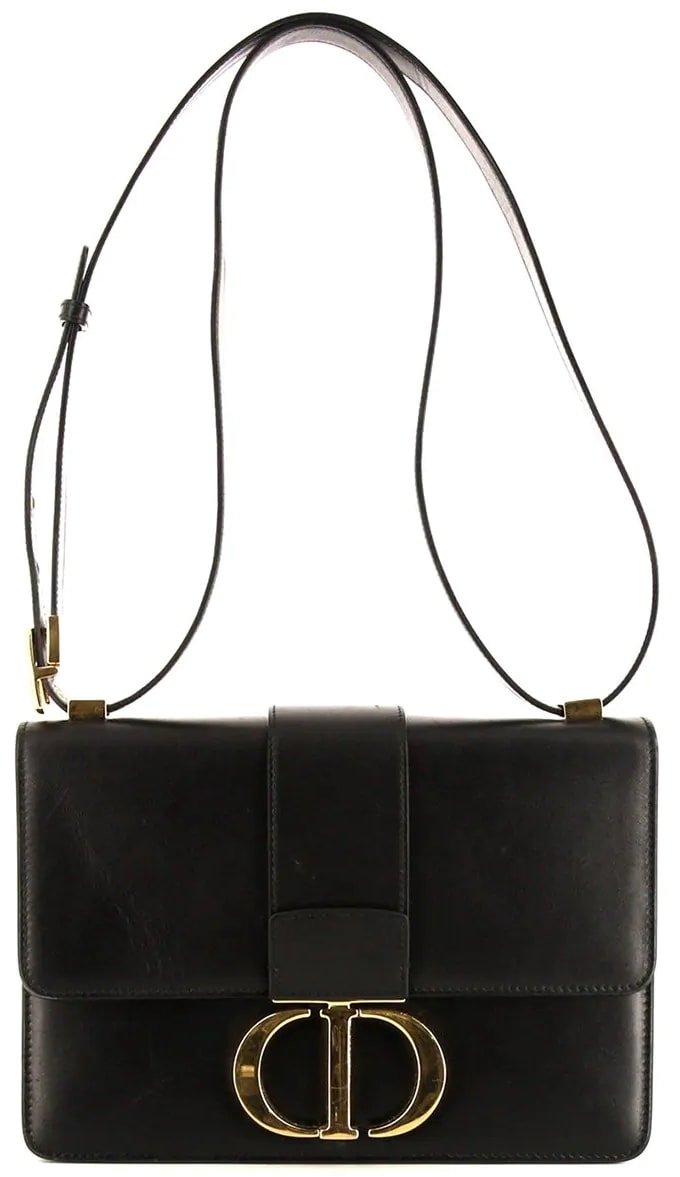 Adorned with a gold-tone CD clasp fastening, this black 30 Montaigne shoulder bag from Christian Dior will boost your looks and your mood