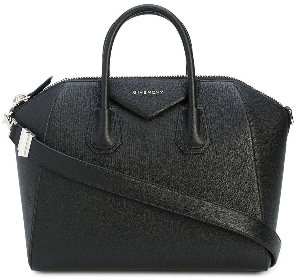 """Considered as Givenchy's """"it"""" bag, the Antigona is characterized by the round top handles, top zip, and trapezoid shape with triangular logo patch"""