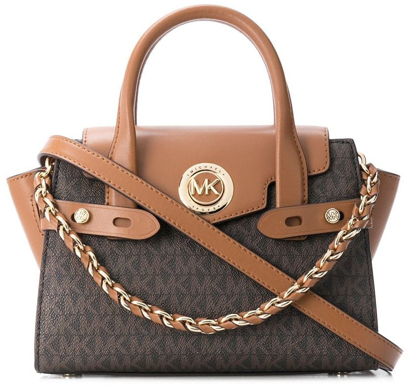 Easily identified by its trapeze shape, the Michael Kors Carmen belted bag can be carried using the top handles or the crossbody strap