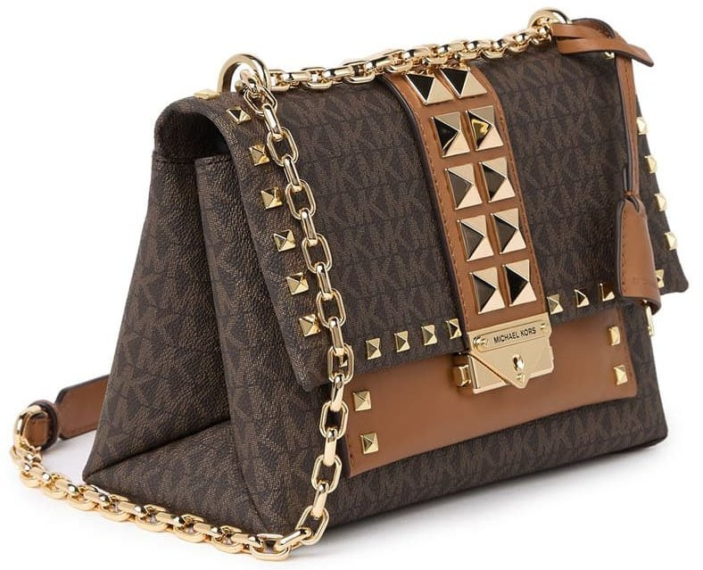 Pyramid studs add sophisticated edge to the logo-printed smooth leather exterior of the Cece crossbody bag