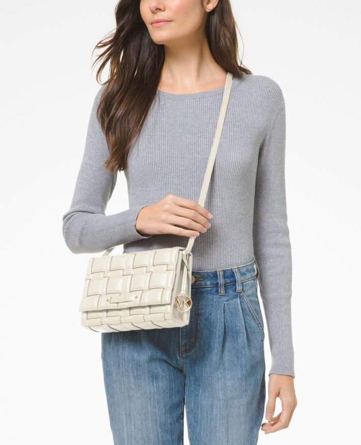It's a crossbody bag with a roomy interior to carry your day to evening essentials