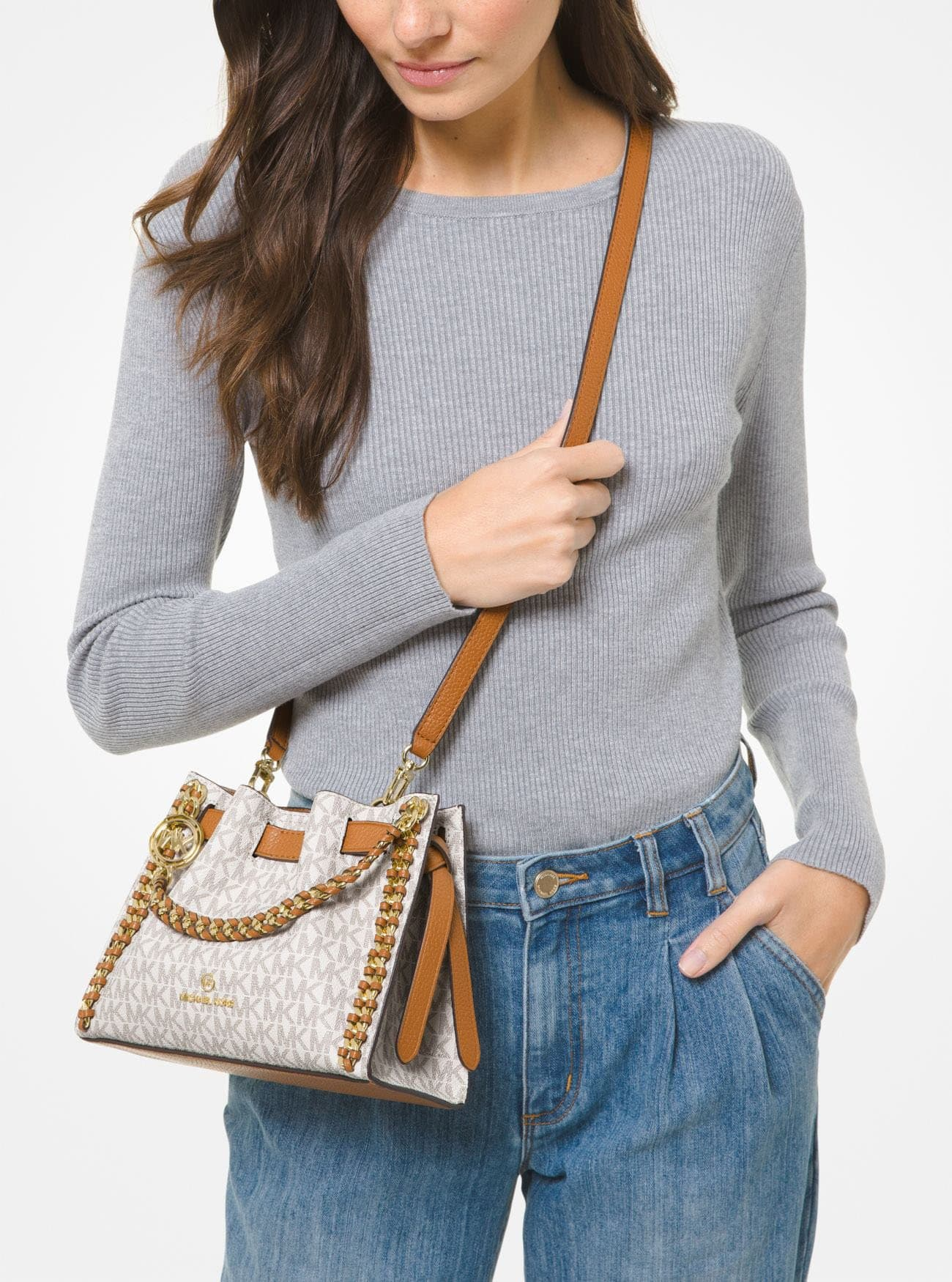 Carry it using the braided leather-and-chain top handles or the adjustable crossbody strap