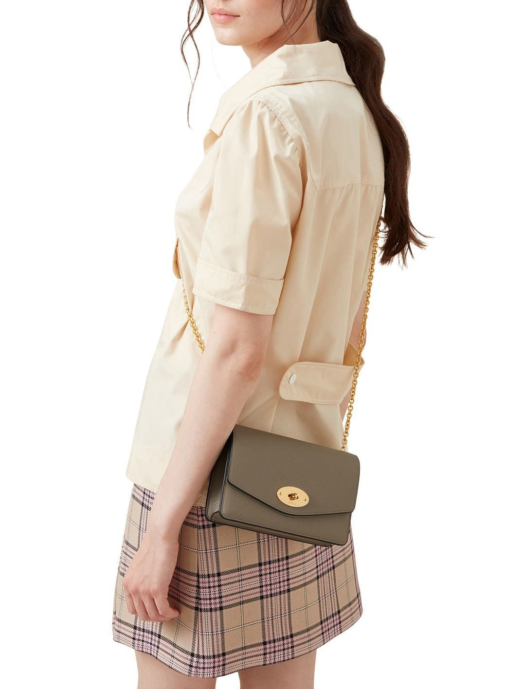 Carry it as a crossbody bag during the day and as a clutch at night with its removable chain strap