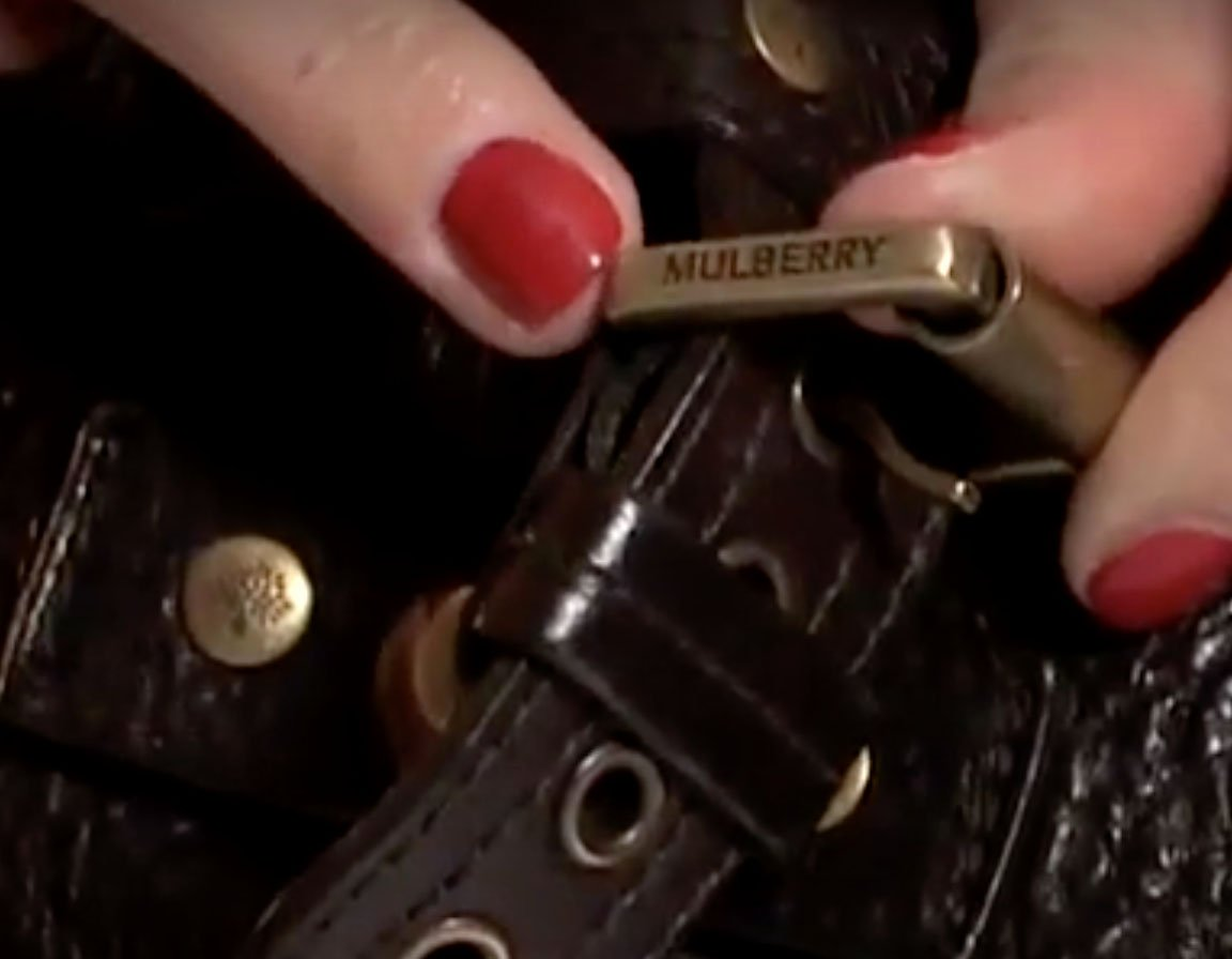 Authentic Mulberry bags should have the Mulberry name and tree logo engraved on the small hardware as shown in the screenshot from Pose YouTube channel