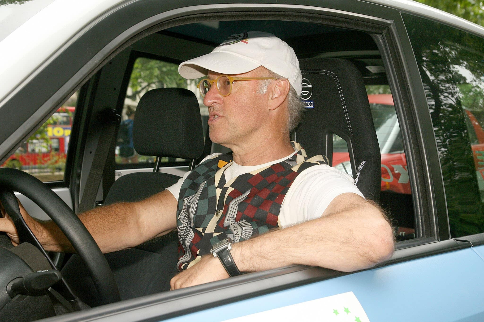 Roger Saul, founder of Mulberry fashion label, driving an electric car during the 2010 Brighton to London Eco Rally on July 7, 2010
