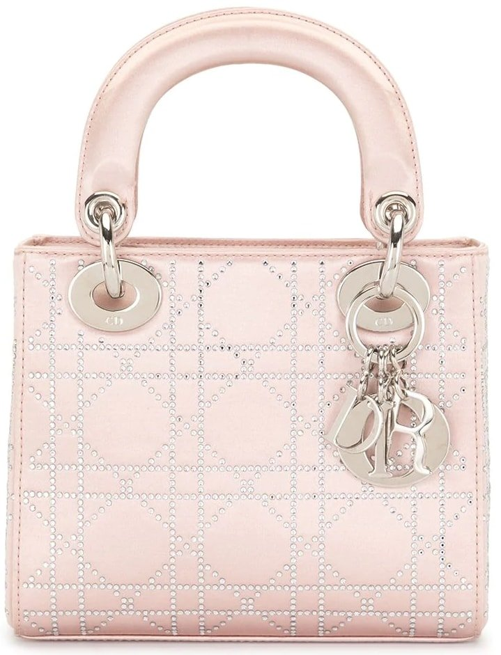 Inspired by Napoléon II Cannage chairs, the Cannage quilt from Christian Dior is a unique and charming signature, found all over this pink satin mini Lady Dior Cannage bag