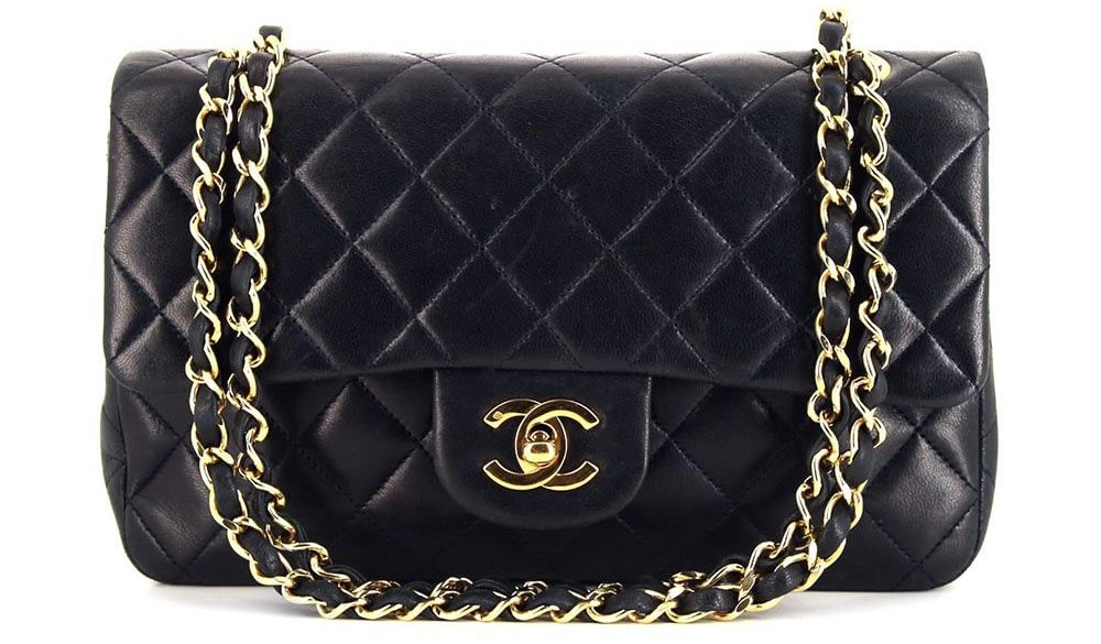 A timeless classic flap bag from 1991 that features the Chanel interlocking CC turn-lock closure