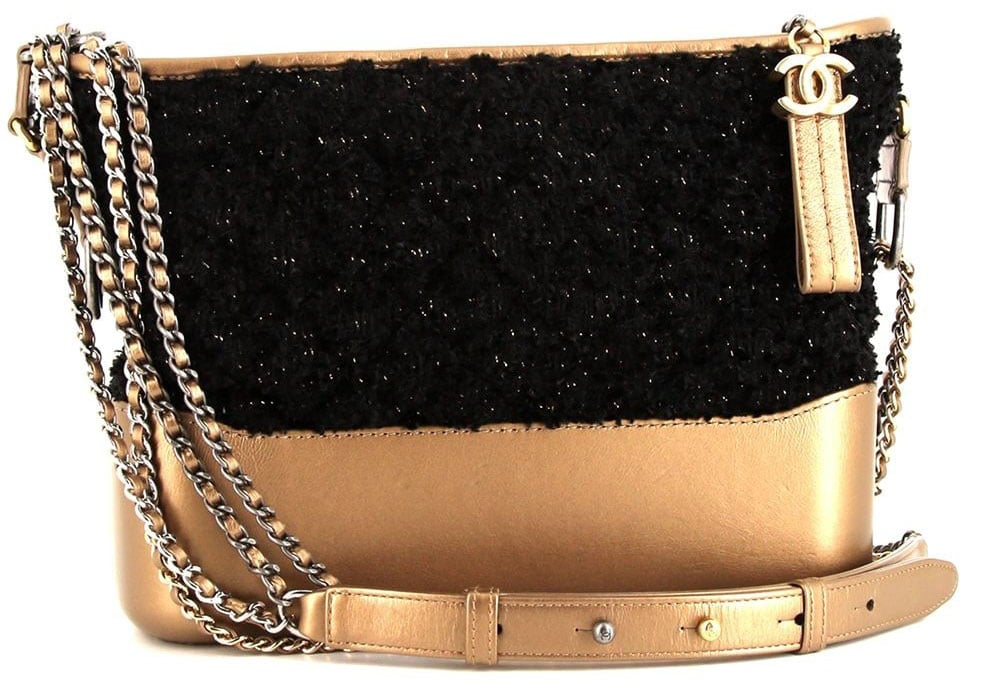This hobo-style Gabrielle bag is crafted from a combination of gold-tone leather and black canvas tweed