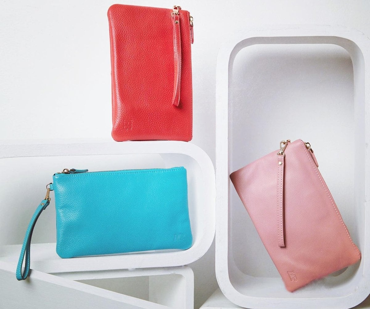 Made of genuine leather, the wristlet features an inbuilt phone charger, to keep your phone charged on-the-go