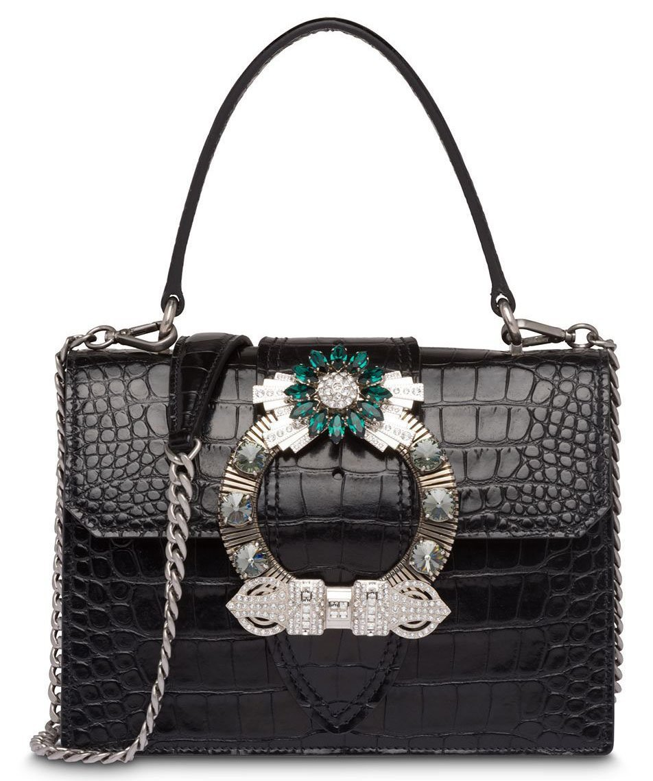 """The Miu Miu """"Miu Lady"""" bag is defined by the crystal buckle on the fold-over flap"""