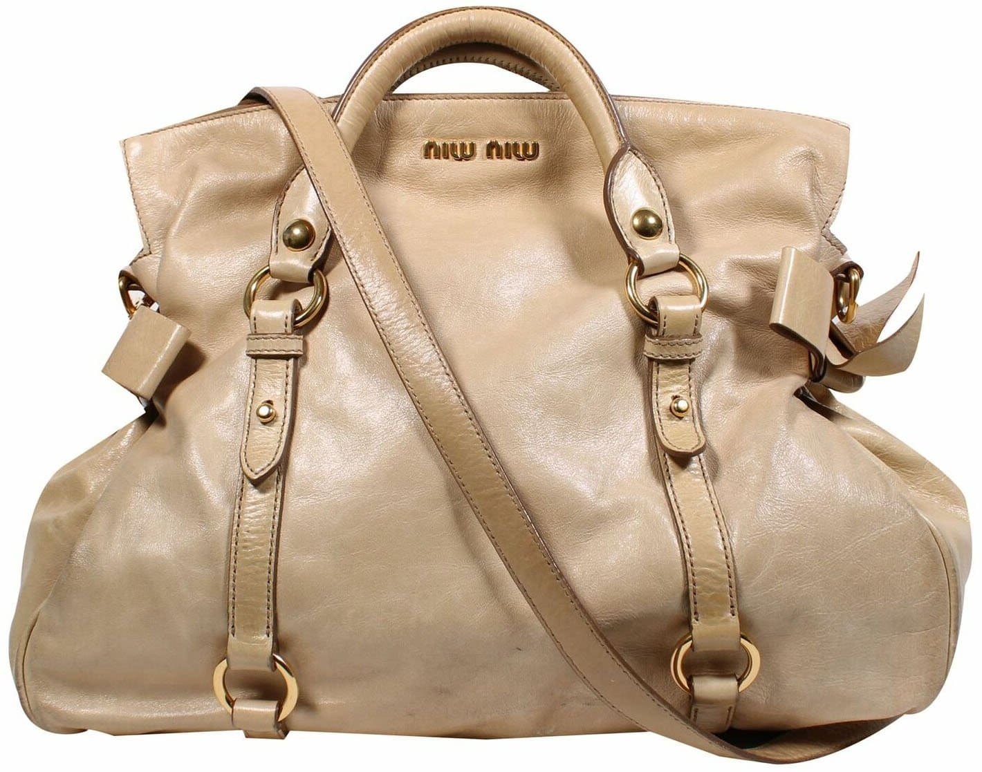 Miu Miu's classic Vitello Bow bag features rolled double top handles with a fold-over top and bow accents on the sides