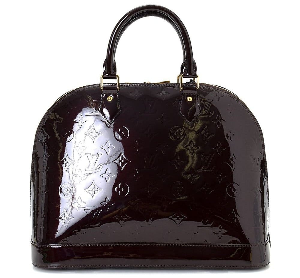 A classic favorite, the Louis Vuitton Alma features an elegant structured design in shiny Monogram Vernis