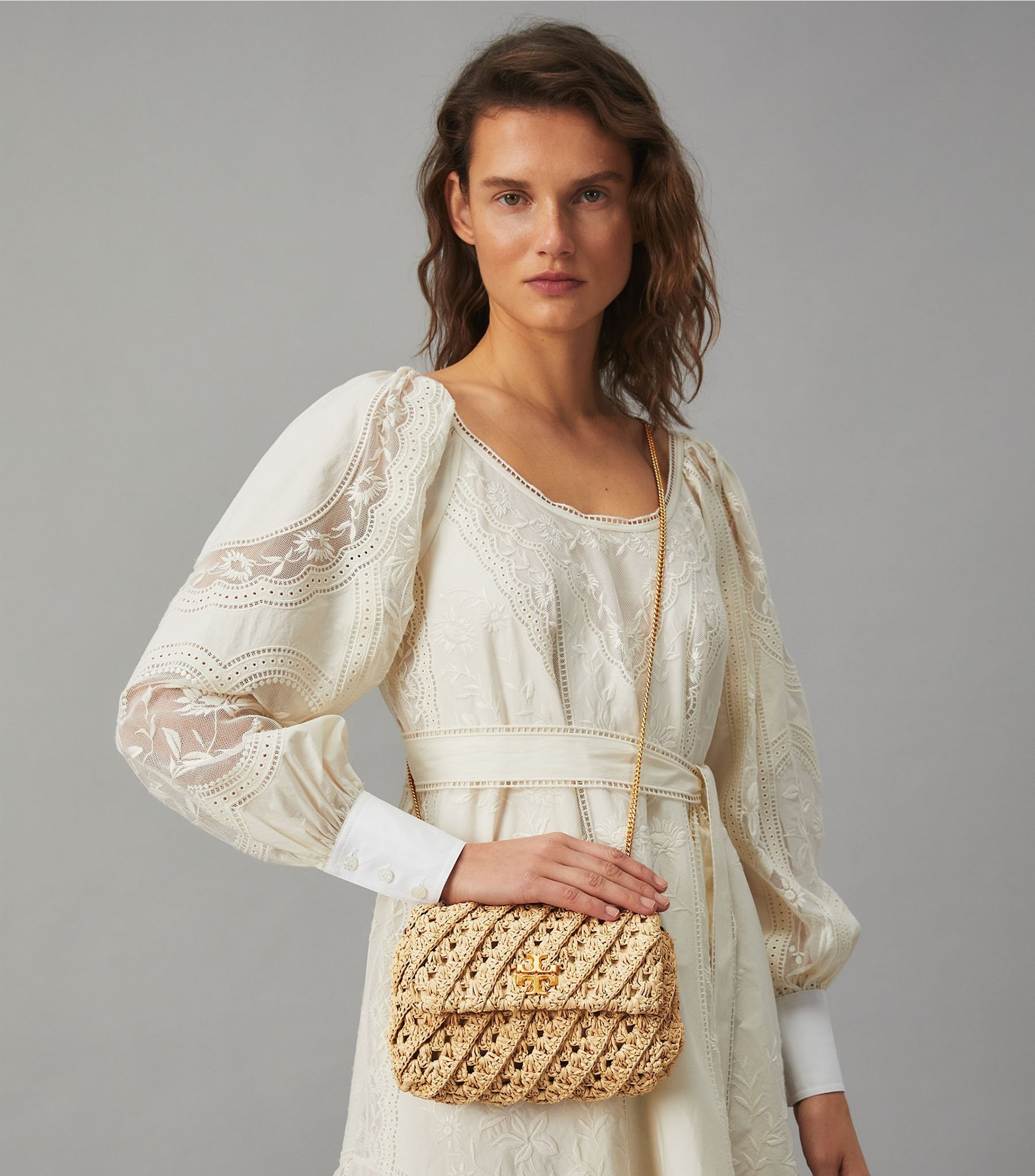 The Kira bag is made from crocheted natural raffia and features the label's double T logo