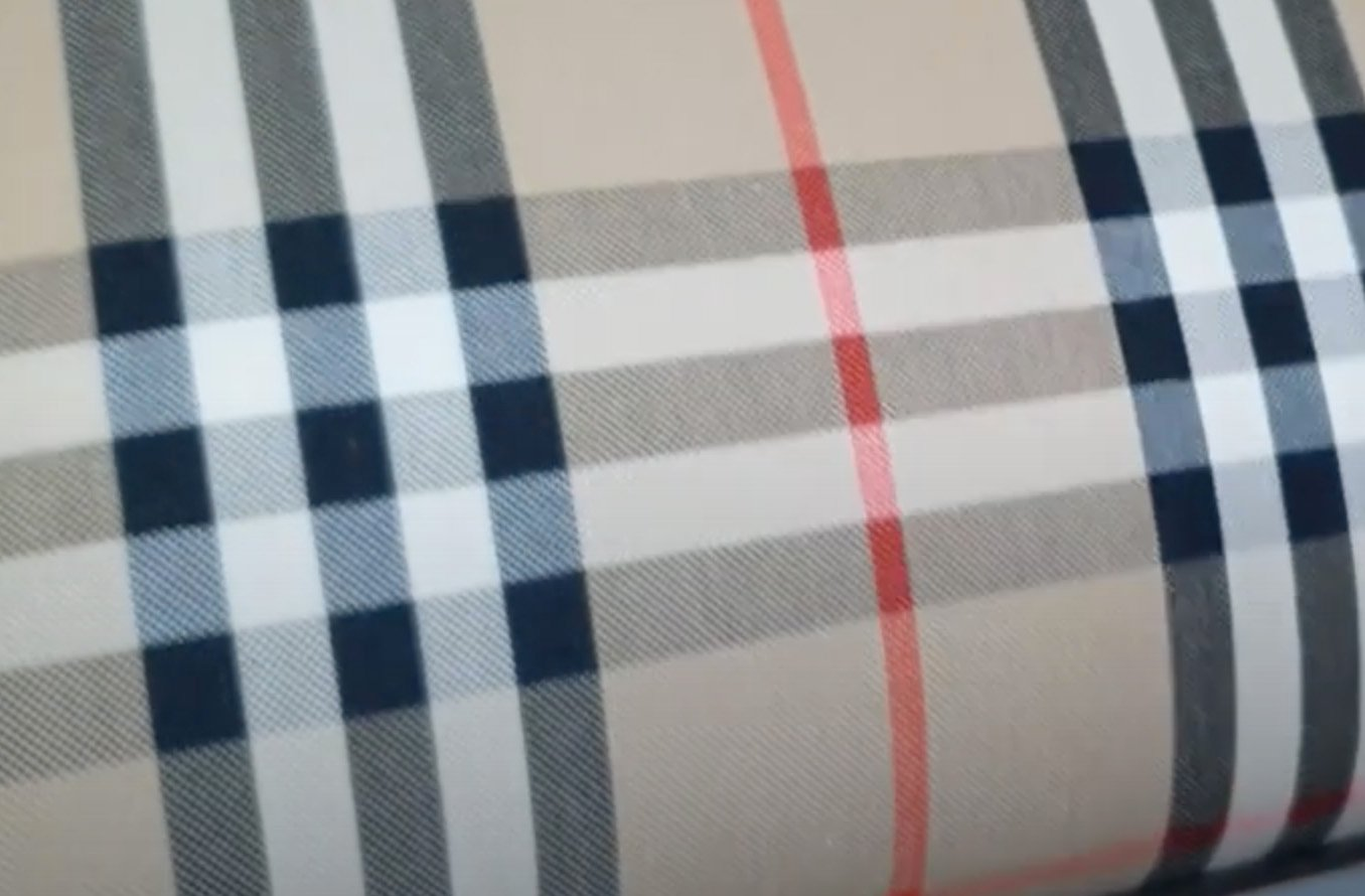 The Nova Check pattern is more modern and has no equestrian knight detail