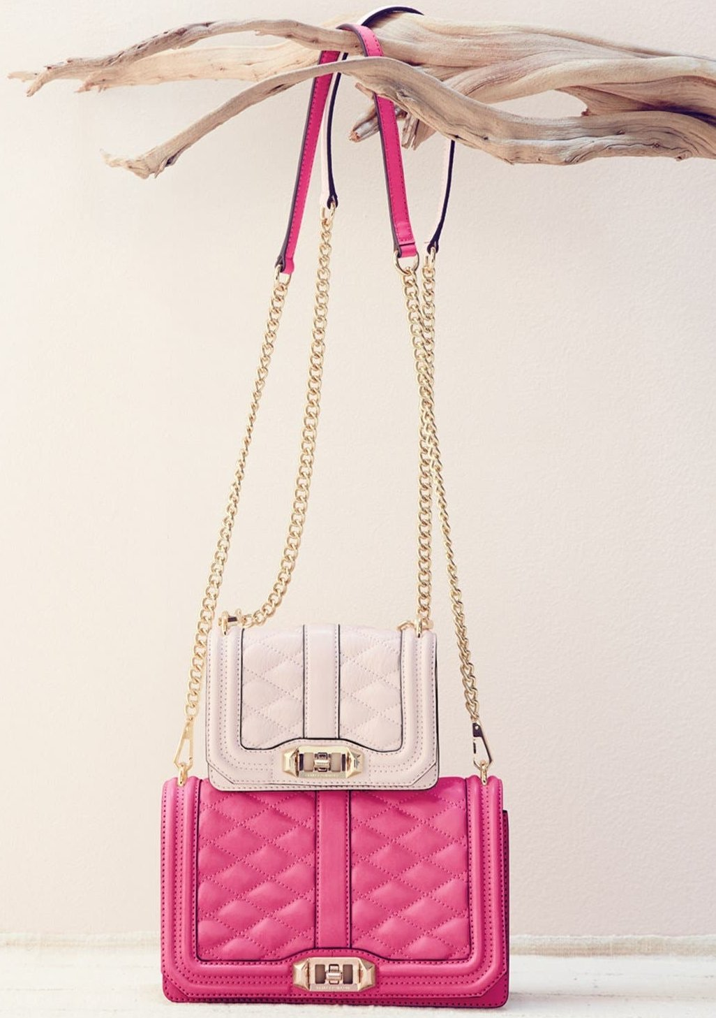 The petite version of the Love crossbody features turn-lock hardware and a chain strap