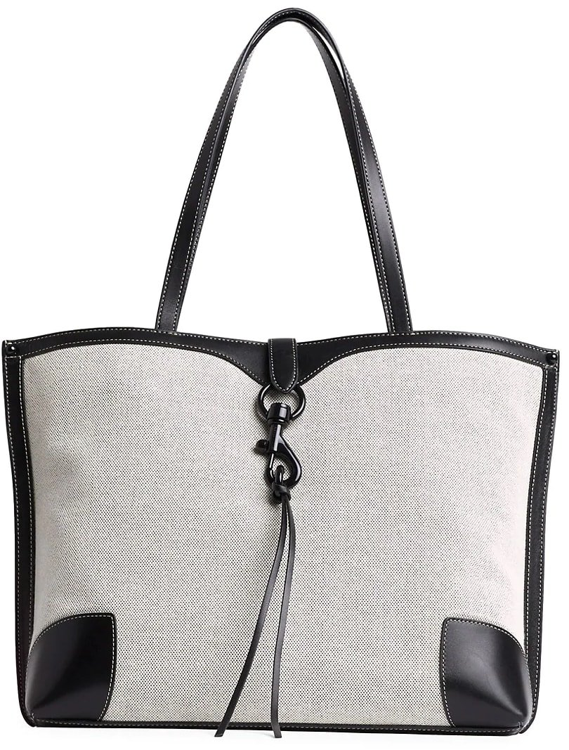 Crafted of rugged canvas with leather-look trim, this classic shopper tote flaunts a utilitarian lobster clip detail