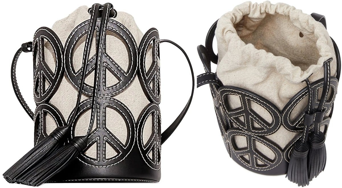 This petite-sized cross-stitch bucket bag is crafted from shiny goat leather in black with peace signs all over
