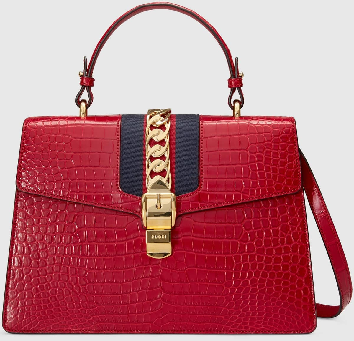 Gucci's Hibiscus red crocodile Sylvie top handle bag decorated with a gold chain and buckle