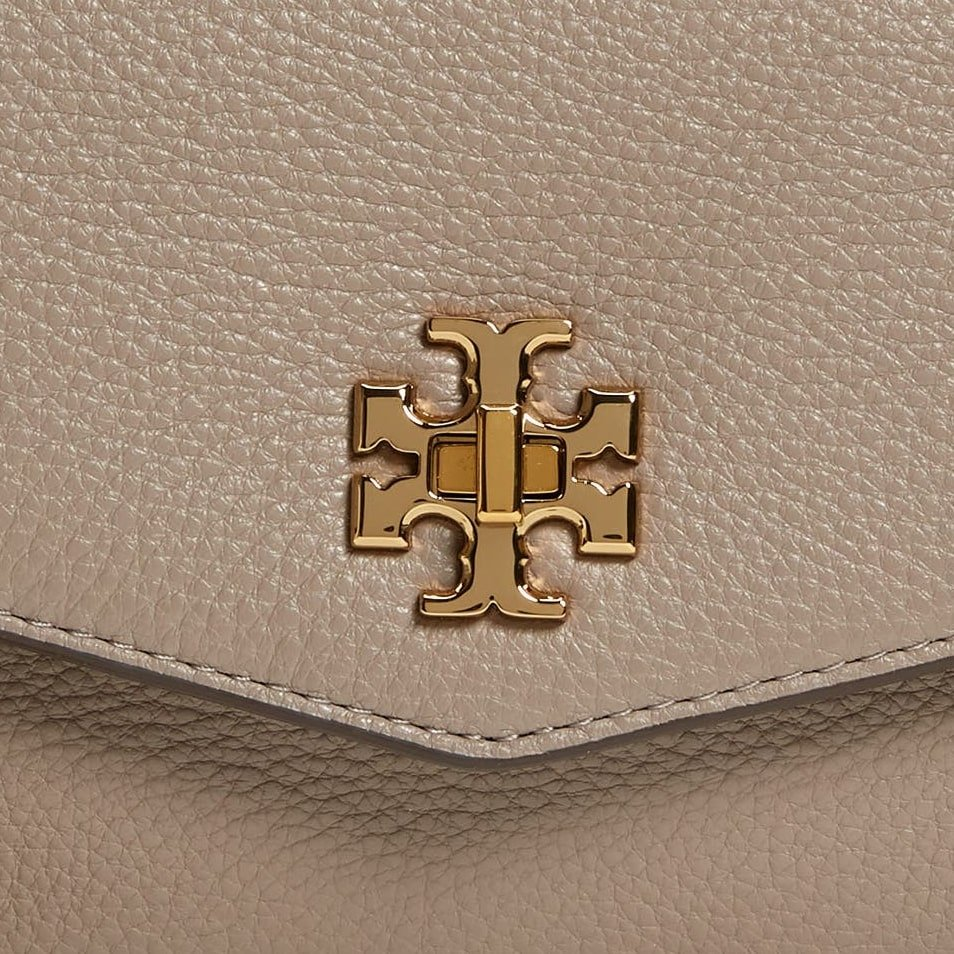 """Tory Burch's cross symbol logo is made up of two letters """"T"""" placed one over the other"""