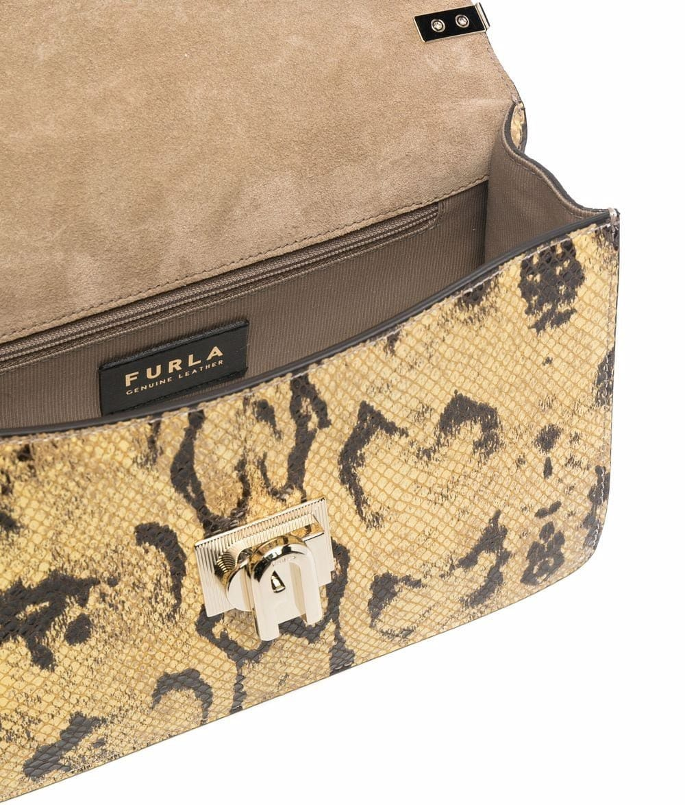 Real Furla bags have the Furla and Genuine Leather tag stitched inside, usually with the Made in Italy stamp